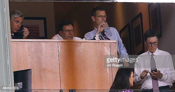 Red Sox executives Sam Kennedy Tom Werner John Henry and Dave Dombrowski watch a threerun home run by Yan Gomes of the Cleveland Indians in the...