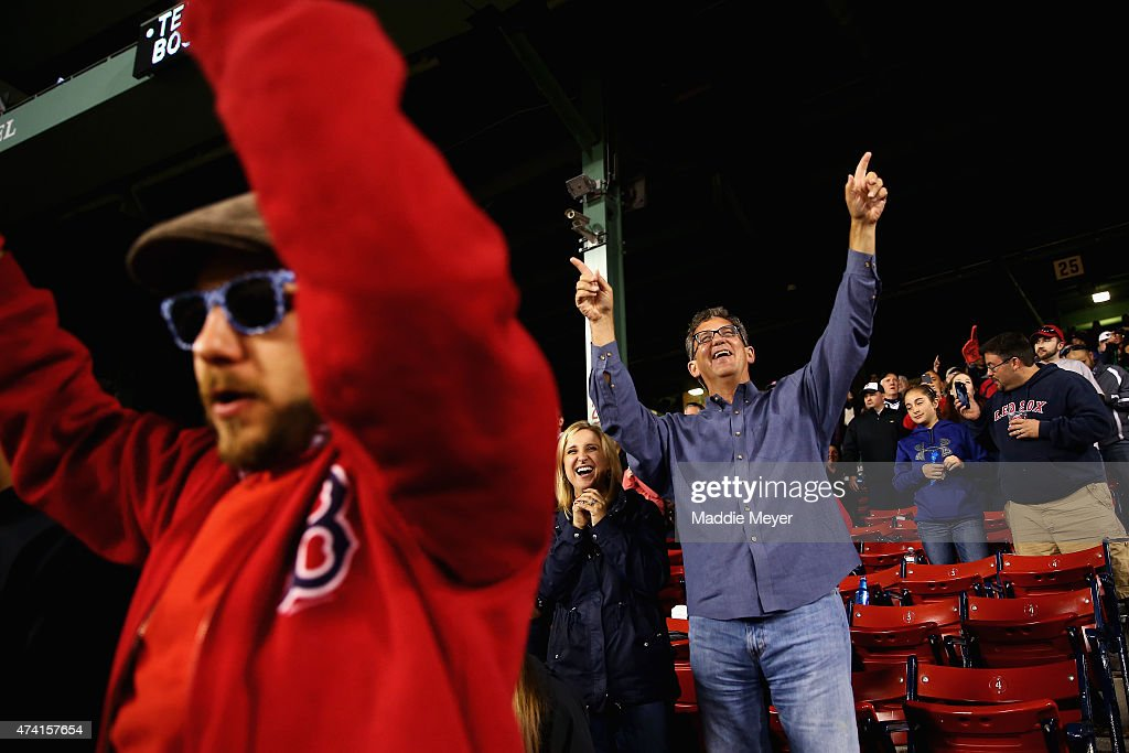 Red Sox fans sing along to Sweet Caroline in the eighth innin against the Texas Rangers at Fenway Park on May 20, 2015 in Boston, Massachusetts. The Rangers defeat the Red Sox 2-1.