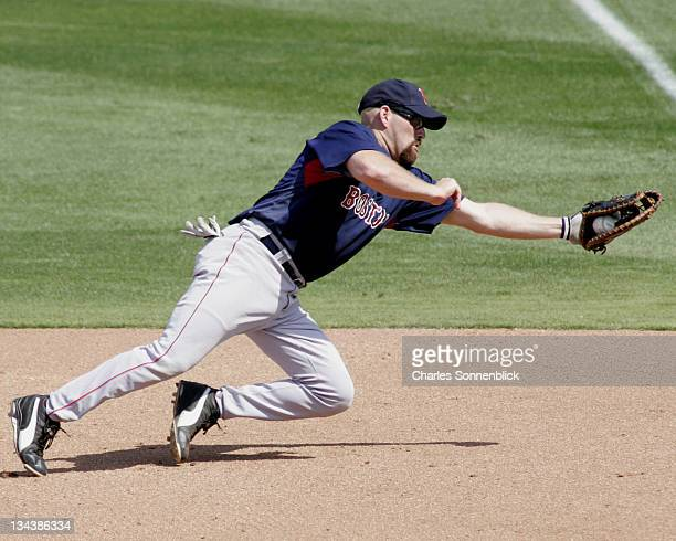 Red Sox first baseman Kevin Youkilis makes a diving catch in a spring training game against the Phillies on March 9 2007 at Bright House Networks...