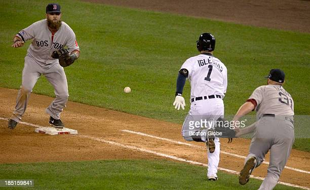 Red Sox first baseman Mike Napoli waits for a throw from pitcher Jon Lester to force out Jose Iglesias of the Tigers to end the fourth inning Game...
