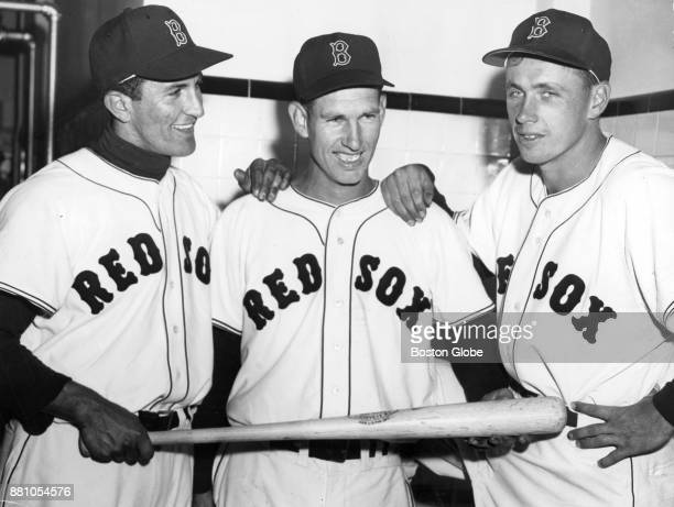 Red Sox Harry Agganis left poses with teammates after his first Red Sox game at Fenway Park in Boston April 15 1954