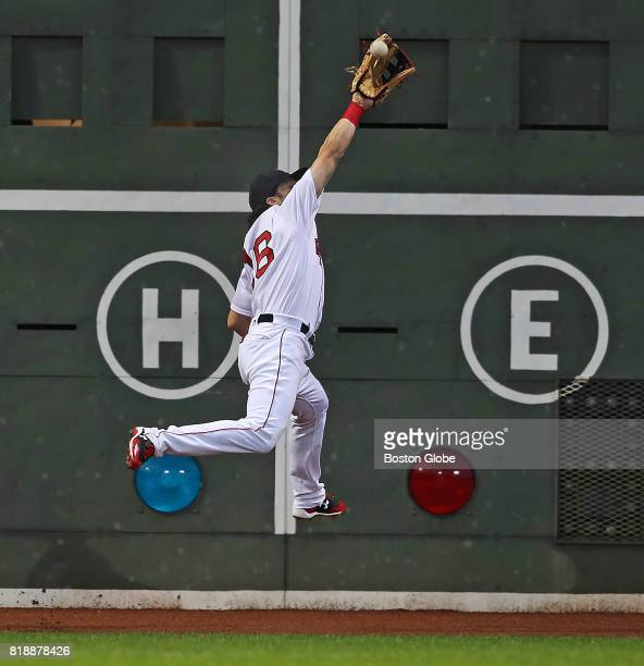 Red Sox left fielder Andrew Benintendi makes a leaping catch to take a hit away from the Blue Jays' Josh Donaldson in the top of the first inning The...