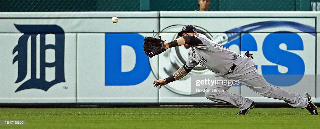 Red Sox left fielder Jonny Gomes made a nice diving catch to rob the Tigers' Prince Fielder of a hit in the seventh inning. The Boston Red Sox visited the Detroit Tigers in Game Three of the American League Champion Series at Comerica Park in Detroit, Mich., Oct. 15, 2013.