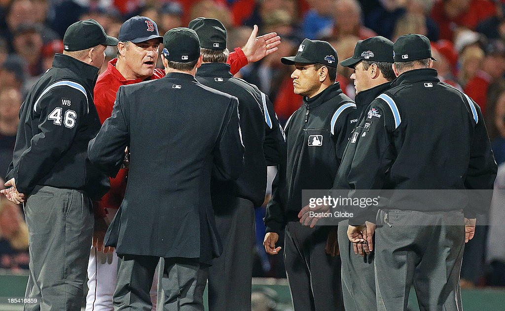 Red Sox manager John Farrell argues with all six umpires after a long shot to left field by Dustin Pedroia was ruled a foul ball and not a three run home run. The umpires checked the replay and the call was upheld. The Boston Red Sox hosted the Detroit Tigers in Game Six of the American League Champion Series at Fenway Park on Oct.19, 2013.