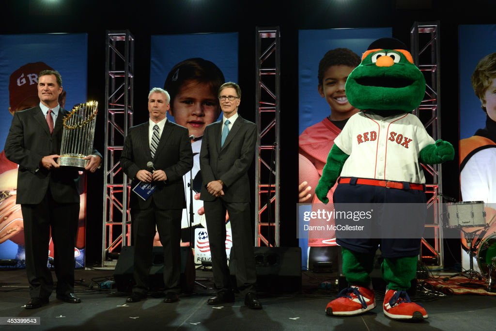 Red Sox manager John Farrell, emcee Dan Roche, Red Sox Owner John Henry and Wally The Green Monster attend Champions for Children's at Seaport World Trade Center on December 3, 2013 in Boston, Massachusetts.