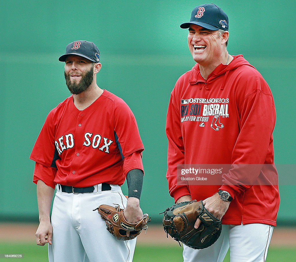 Red Sox manager John Farrell (right) has a laugh as he chats with second baseman Dustin Pedroia (left) during batting practice. The Boston Red Sox had a workout at Fenway Park in preparation for Game One of the ALCS against either Oakland or Detroit.