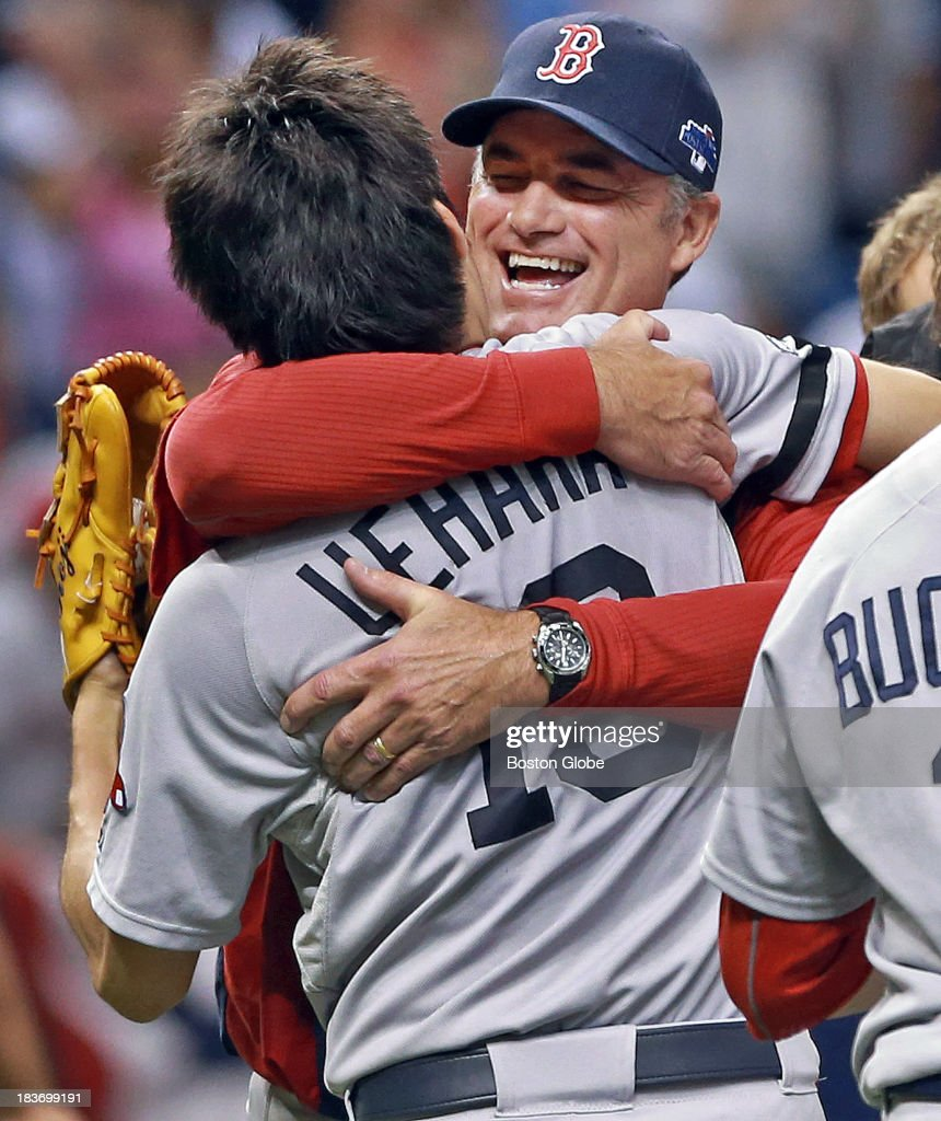 Red Sox manager John Farrell hugs closer Koji Uehara during the on field celebration after the Boston victory. The Boston Red Sox visited the Tampa Bay Rays in Game Four of the ALDS baseball playoffs at Tropicana Field.
