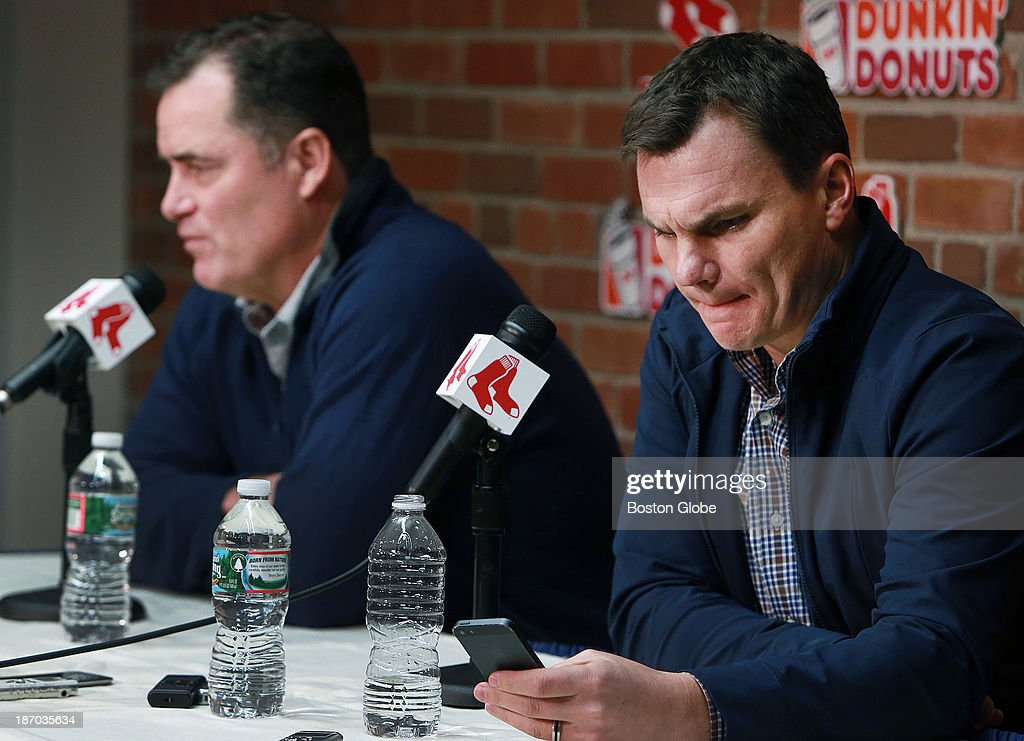 Red Sox manager John Farrell, left, and GM Ben Cherington, right, met with reporters this afternoon at Fenway Park to discuss the team's off season plans. As Farrell was answering a question, Cherington reacted to something he saw as he looked at his phone.