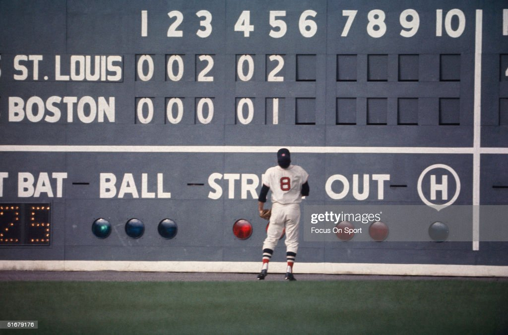 Red Sox outfielder Carl Yastrzemski stares at the 'green monster' the 37' tall left field wall at Fenway Park during the 1967 World Series against...