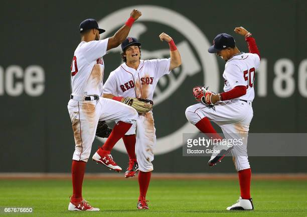 Red Sox outfielders from left Chris Young Andrew Benintendi and Mookie Betts celebrate the Sox win in the outfield at the end of the game The Sox...