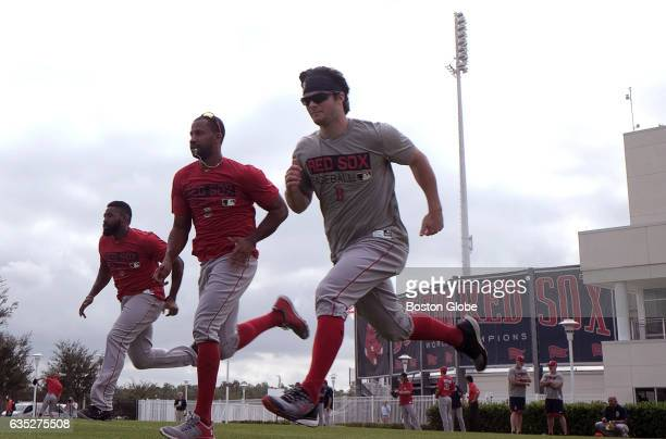 Red Sox outfielders Jackie Bradley Jr Chris Young and Andrew Benintendi run during drills Pitchers and catchers report for spring training at Jet...