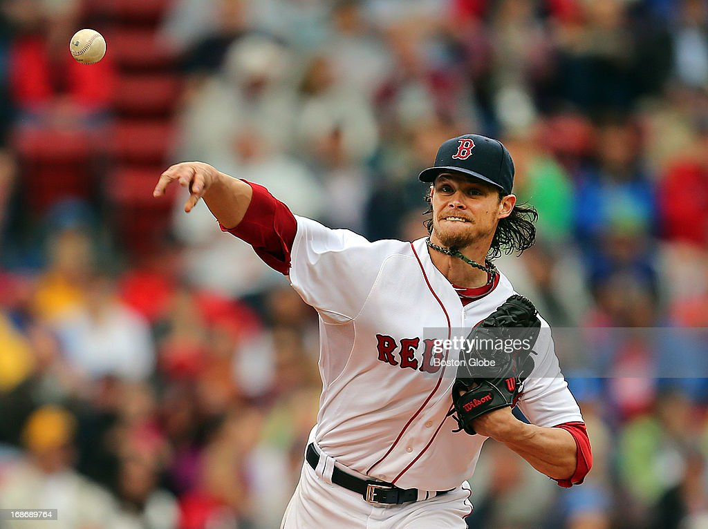 Red Sox pitcher Clay Buccholz fires the ball to first base as he tries to pick off Toronto's Adam Lind, who took a big lead off the base in the second inning, as the Boston Red Sox play the Toronto Blue Jays at Fenway Park.