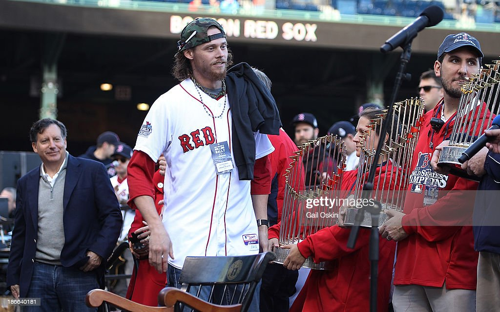 Red Sox pitcher Clay Buchholz runs up to the stage to address the crowd at Fenway Park before boarding the duck boats for the Boston Red Sox victory parade on November 2, 2013 in Boston, Massachusetts.