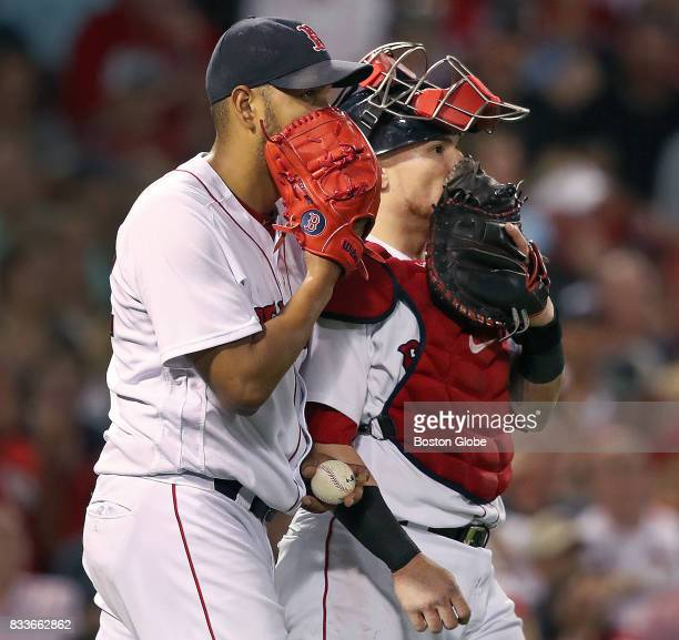 Red Sox pitcher Eduardo Rodriguez left and catcher Christian Vazquez have a private conversation after the Cardinals put runners on second and third...