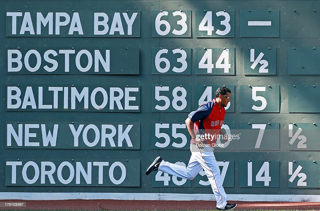 Red Sox pitcher Feliz Doubront gets in some running during batting practice as the standings reflect the fact that Boston is now in second place in the American League East, a half game behind the Tampa Bay Rays. The Boston Red Sox hosted the Seattle Mariners in an MLB regular season baseball game at Fenway Park.