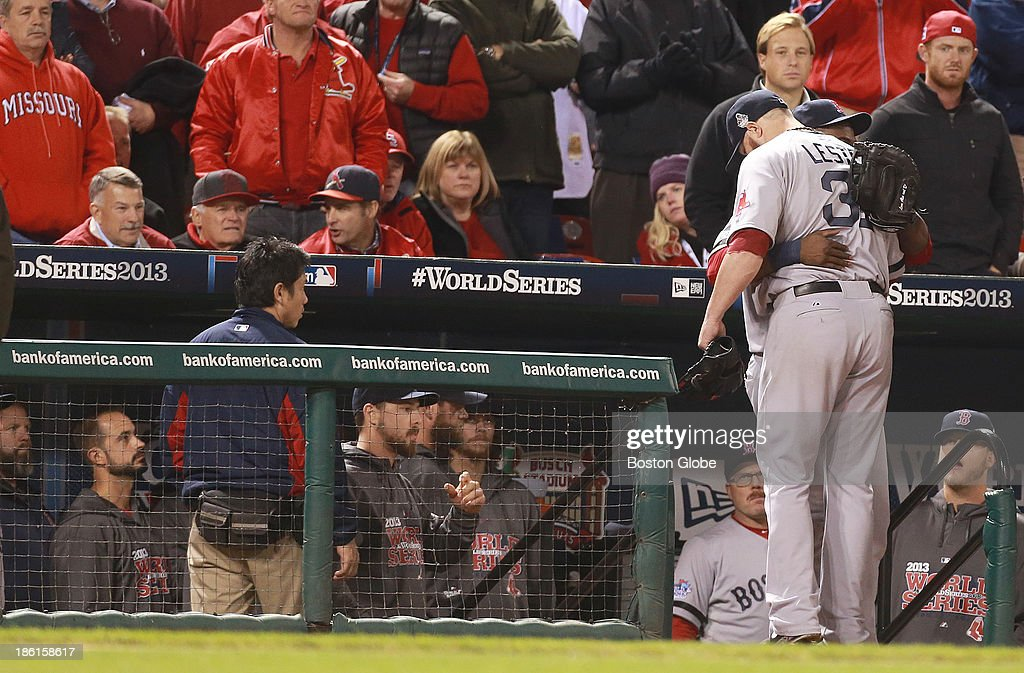 Red Sox pitcher Jon Lester gets a hug from David Ortiz after being pulled from the game in the eighth inning during Game Five of the 2013 Major League Baseball World Series between the St. Louis Cardinals and Boston Red Sox at Busch Stadium, Oct. 28, 2013.