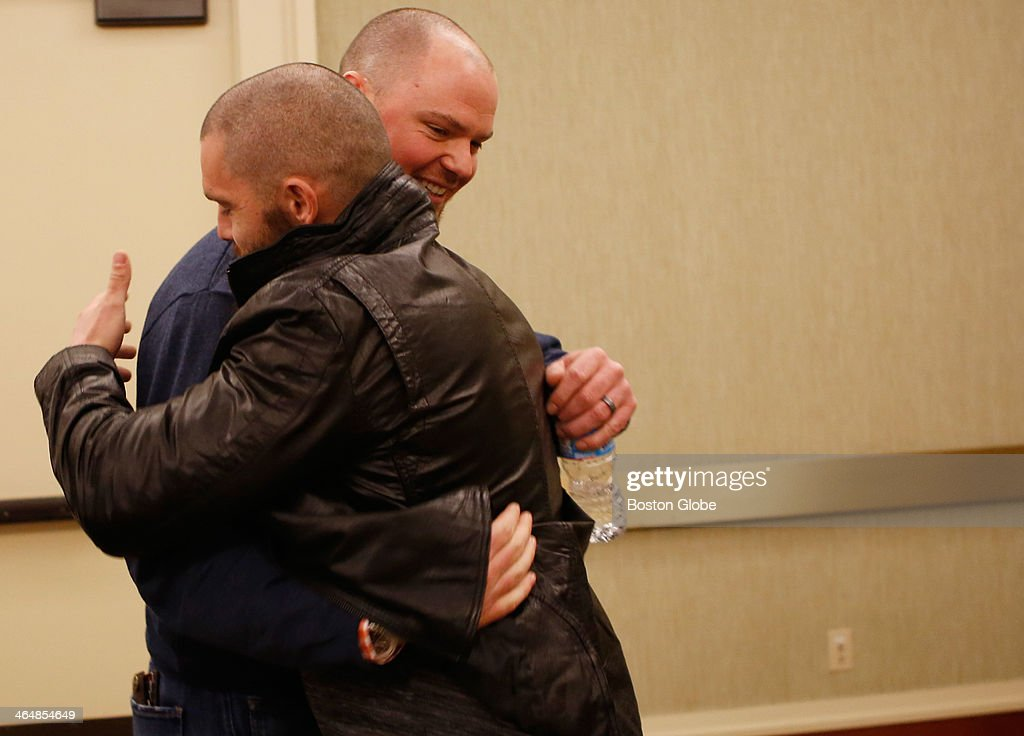 Red Sox pitcher Jon Lester, right, hugs fellow teammate Jonny Gomes after the two spoke to the media during a press availability at the Westin Copley Plaza in Boston, Jan. 23, 2014.