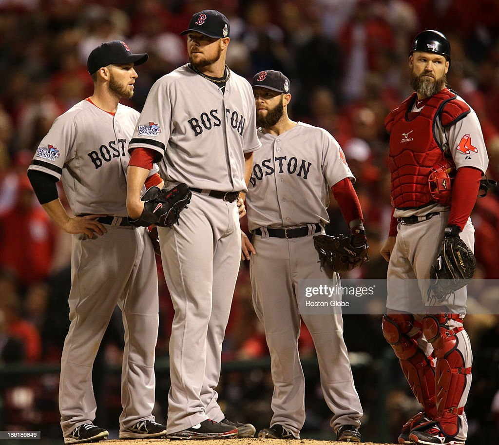 Red Sox pitcher Jon Lester, second from left, waits to be taken out of the game during the eighth inning. Other players are, from left to right: Stephen Drew, Lester, Dustin Pedroia and David Ross. The St. Louis Cardinals host the Boston Red Sox at Busch Stadium for Game Five of the 2013 Major League Baseball World Series, Oct. 28, 2013.