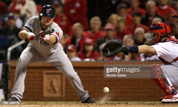 Red Sox pitcher Jon Lester strikes out bunting four during the fifth inning Cardinals catcher is Yadier Molina The St Louis Cardinals host the Boston...
