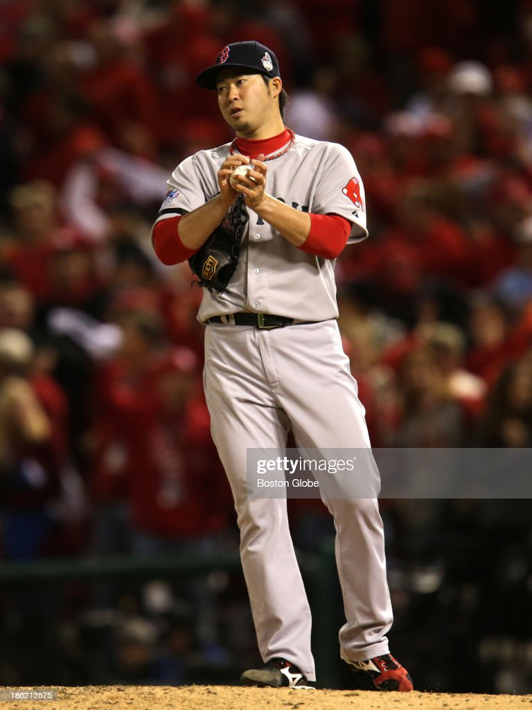 Red Sox pitcher Junichi Tazawa after the Cardinals scored two runs in the seventh inning. The St. Louis Cardinals host the Boston Red Sox at Busch Stadium for Game Three of the 2013 Major League Baseball World Series, Oct. 26, 2013.