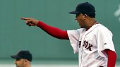 Red Sox pitcher Pedro Martinez points at Yankees catcher Jorge Posada after the argument at second base between Todd Walker and Karim Garcia started...