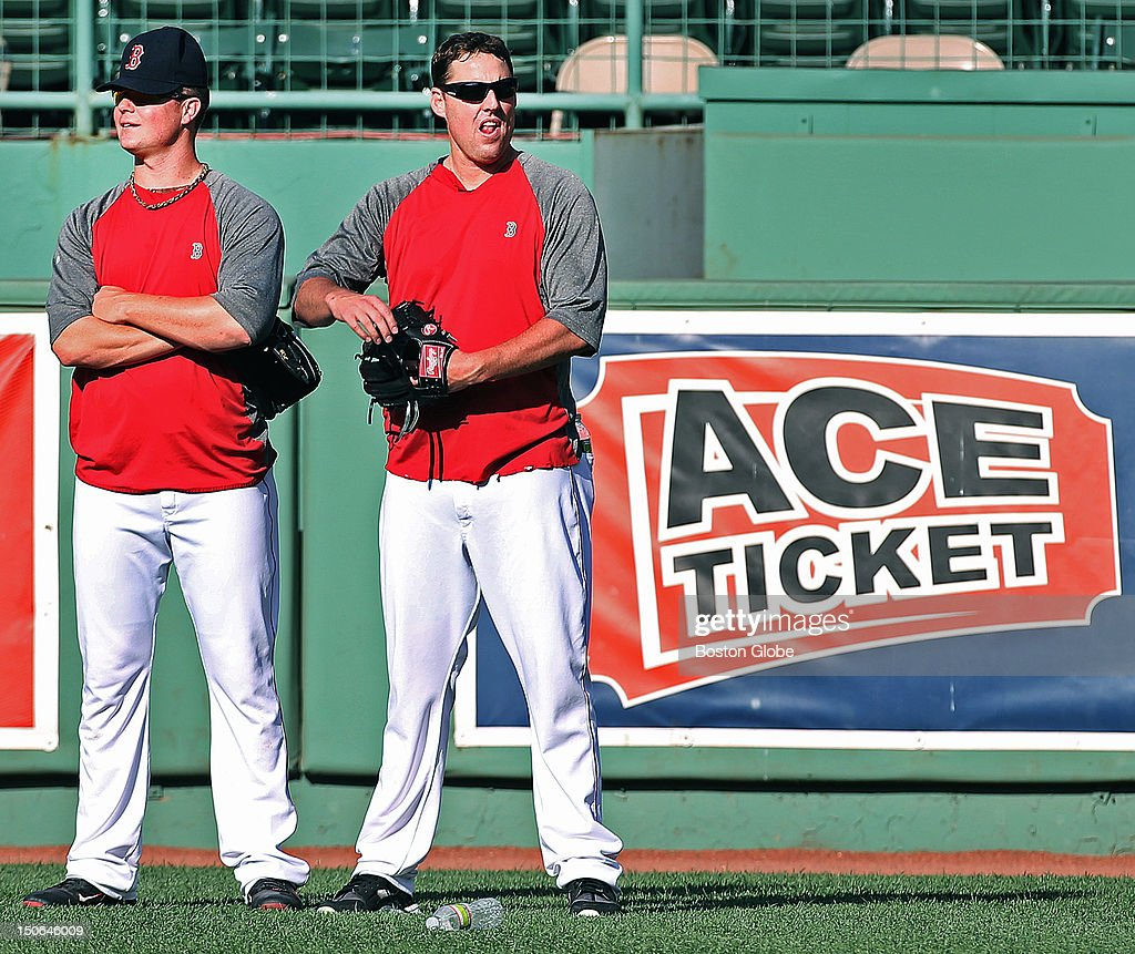 Red Sox pitchers Jon Lester, left, and John Lackey, right, hang out together in right field during batting practice before the Boston Red Sox hosted the Los Angeles Angels in an MLB game at Fenway Park.