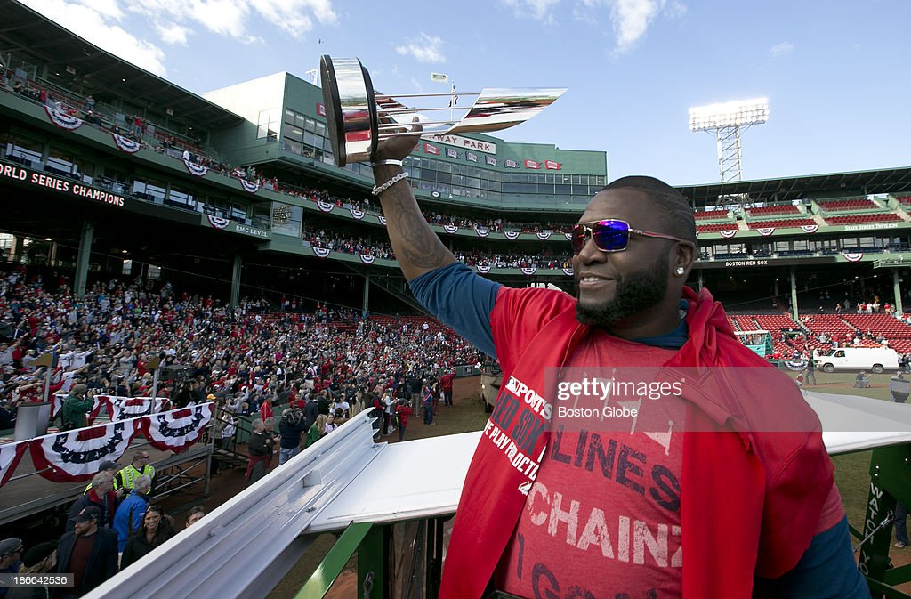 Red Sox player David Ortiz with the MVP trophy at Fenway Park at the start of the Red Sox's 2013 World Series Rolling Rally victory parade in Boston on Saturday, Nov. 2, 2013.