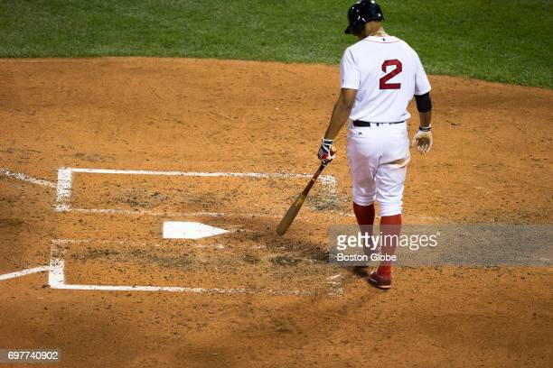 Red Sox player Xander Bogaerts helps erase the back line of the batter's box in a game against Detroit at Fenway Park in Boston on Jun 10 2017...