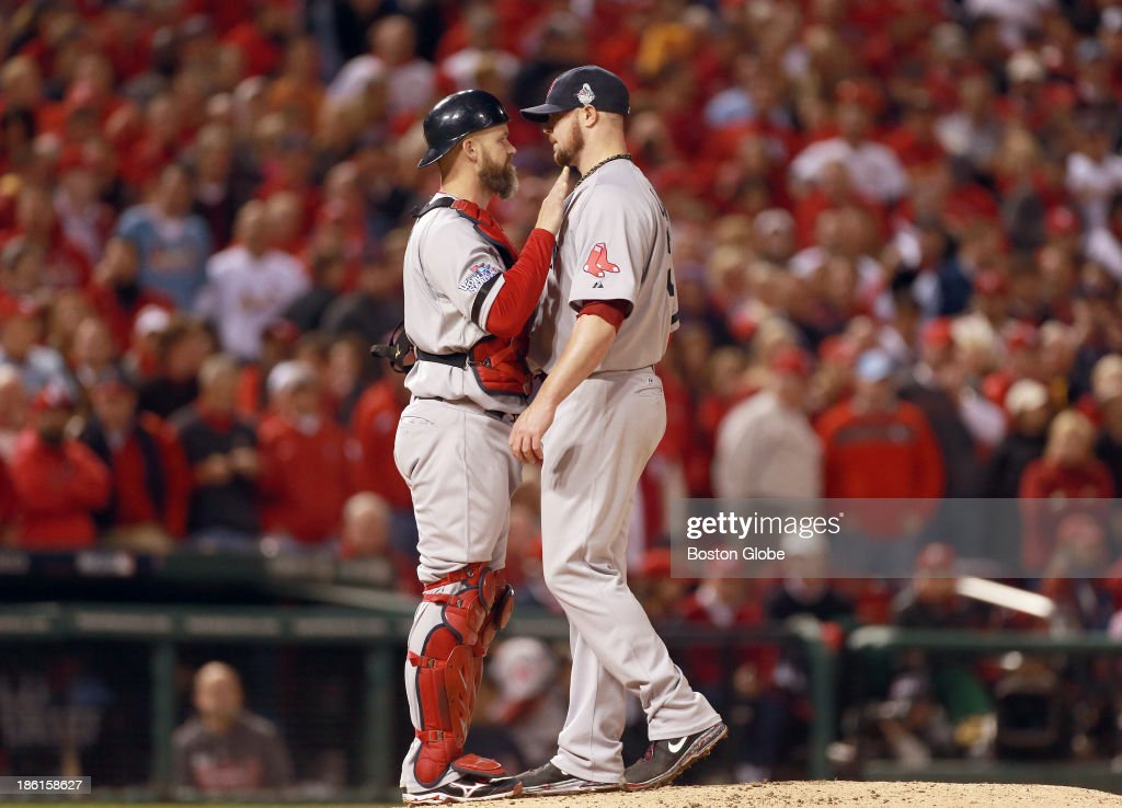 Red Sox players David Ross and Jon Lester share a moment before Lester was pulled from the game in the eighth inning during Game Five of the 2013 Major League Baseball World Series between the St. Louis Cardinals and Boston Red Sox at Busch Stadium, Oct. 28, 2013.