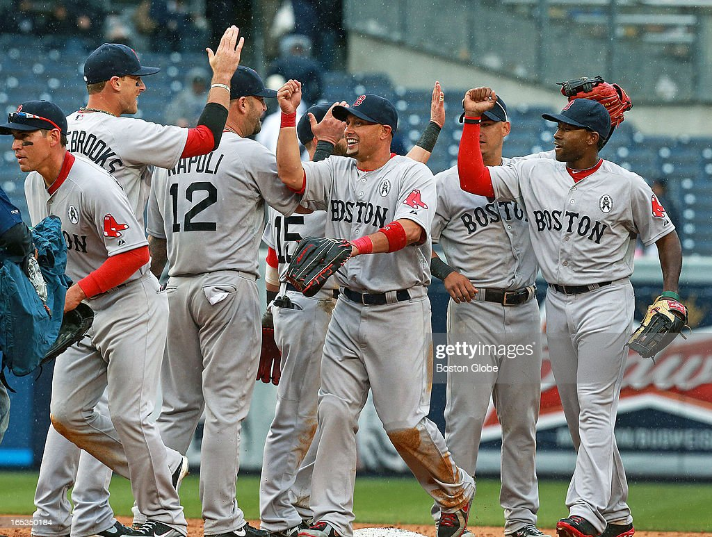 Jacoby Ellsbury, Will Middlebrooks Mike Napoli, Dustin Pedroia (#15), Shane Victorino, Jose Iglesia, and Jackie Bradlye Jr. celebrate following their victory. The Boston Red Sox play the New York Yankees at Yankee Stadium during Opening Day of the 2013 MLB season.