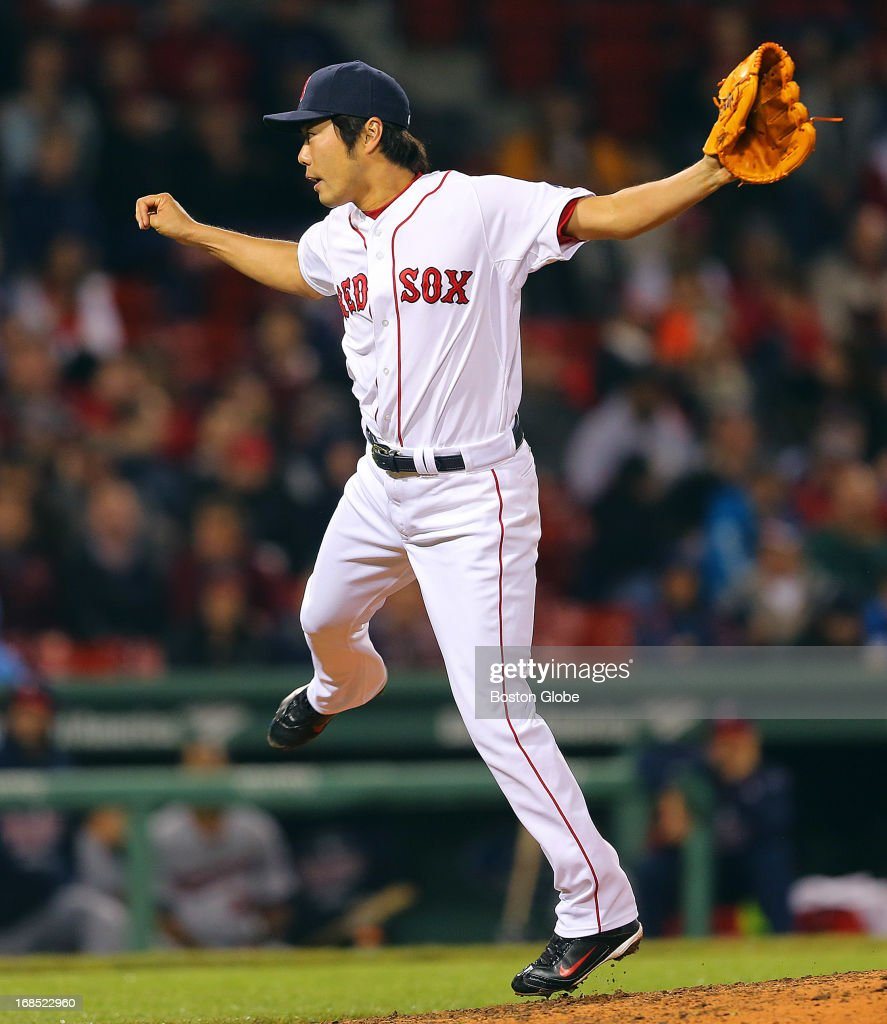 Red Sox relief pitcher Koji Uehara follows through on an eighth inning pitch. The Boston Red Sox played the Minnesota Twins at Fenway Park on May 9, 2013.