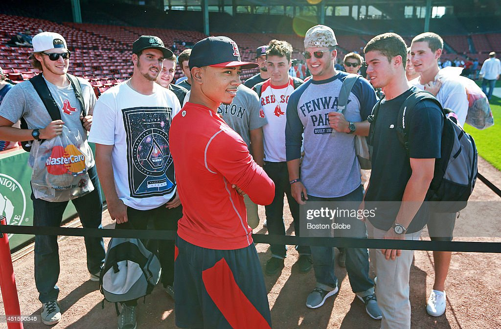 Red Sox rookie Mookie Betts will make his Fenway Park debut tonight, starting in center field and batting in the number eight spot in the lineup. Boston did not take batting practice before the game, so it gave Betts a chance to chat with a group of Lowell Spinners players who were on hand before the game. The Boston Red Sox hosted the Chicago Cubs in an inter league MLB game at Fenway Park.