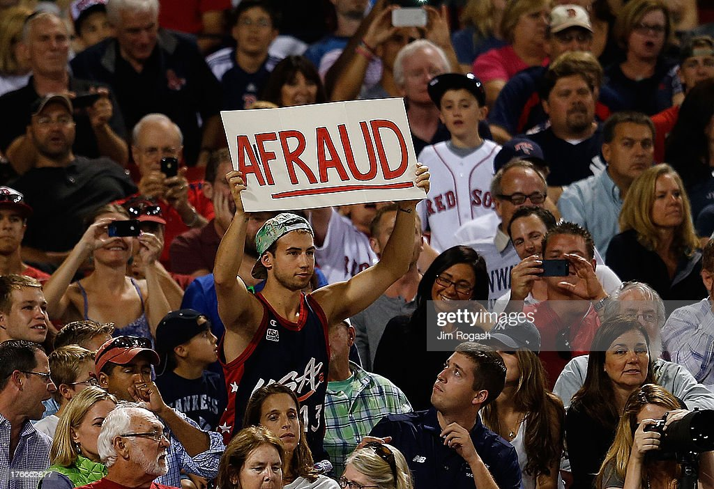 A Red Sox shows his feelings toward Alex Rodriguez #13 of the New York Yankees by holding a sign during a game against the Boston Red Sox in the 9th inning at Fenway Park on August 16, 2013 in Boston, Massachusetts.