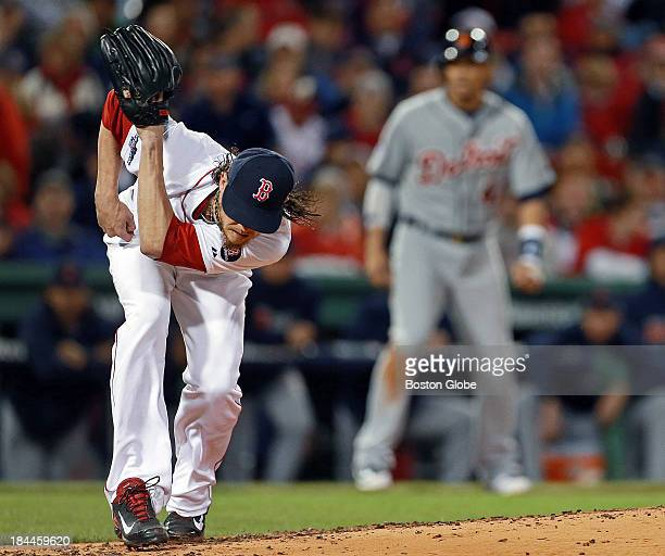 Red Sox starting pitcher Clay Buchholz ducks out of the way as a ball hit by the Tigers Alex Avila whizzes by him into center field for a second...