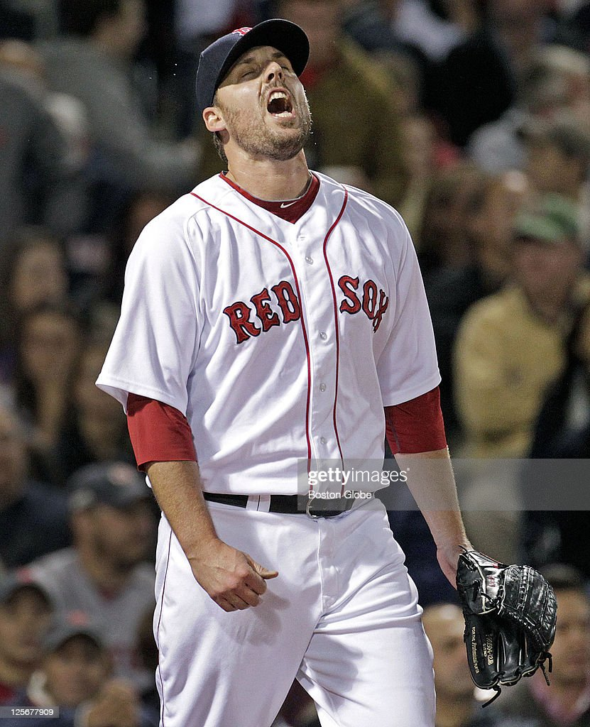 Red Sox starting pitcher John Lackey screams after the Orioles scored two third inning runs on a bloop two out single by Nolan Reimold (not pictured). he Boston Red Sox hosted the Baltimore Orioles in the second half of a day-night doubleheader at Fenway Park.