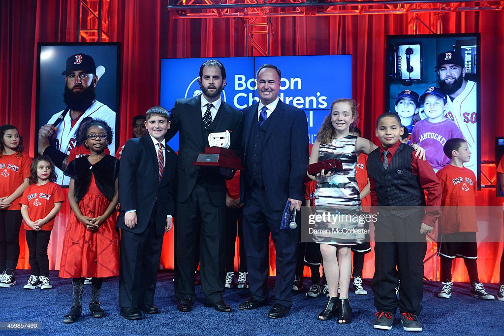 Red Sox's <a gi-track='captionPersonalityLinkClicked' href=/galleries/search?phrase=Mike+Napoli&family=editorial&specificpeople=525007 ng-click='$event.stopPropagation()'>Mike Napoli</a> receives his Champions for Children's award from Stephanie, Carson, <a gi-track='captionPersonalityLinkClicked' href=/galleries/search?phrase=Don+Orsillo&family=editorial&specificpeople=10884648 ng-click='$event.stopPropagation()'>Don Orsillo</a>, Bela and Yahir at Seaport World Trade Center benefitting Boston Children's Hospital December 2, 2014 in Boston, Massachusetts.