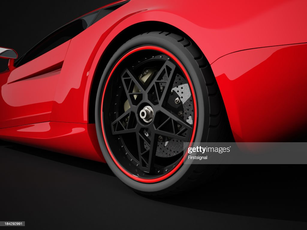 Red sport car on black studio background : Stock Photo