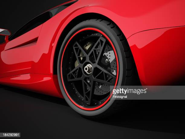 Red sport car on black studio background