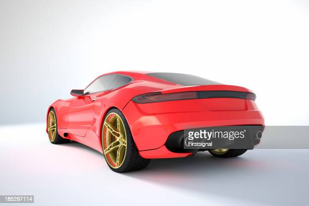 Red sport car with gold and red rims on white background