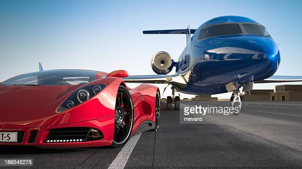 Red sports car and blue luxury jet on runway