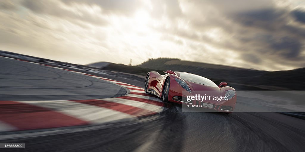 Red sports car on racetrack : Stock Photo