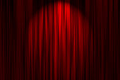 Red Stage Curtain with spot light effect.