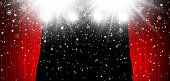 Red stage curtain with spotlight and falling snow christmas background