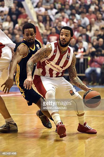 Red Star Belgrade's US guard Marcus Williams vies with Alba Berlin's US center Cliff Hammonds during the Euroleague Top 16 basketball match between...