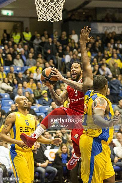 Red Star Belgrade's US guard Marcus Williams vies with Maccabi Electra Tel Aviv's Greek center Sofoklis Schortsanitis during their Euroleague Top 16...