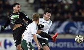 Red Star midfielder Naim Sliti fights for the ball with St Etienne's Turkish forward Mevlut Erding on February 10 2015 during a French Cup match Red...