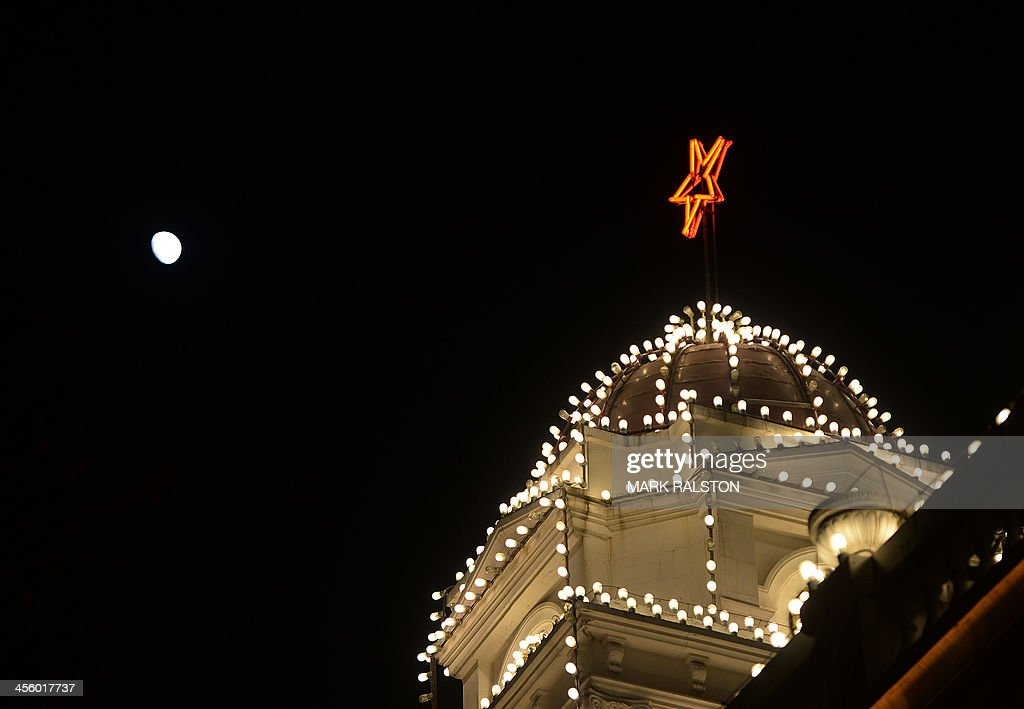 A red star of the Chinese Communist Party seen in front of a view of the moon at Tiananmen Square in Beijing on December 13 2013 China's first lunar...