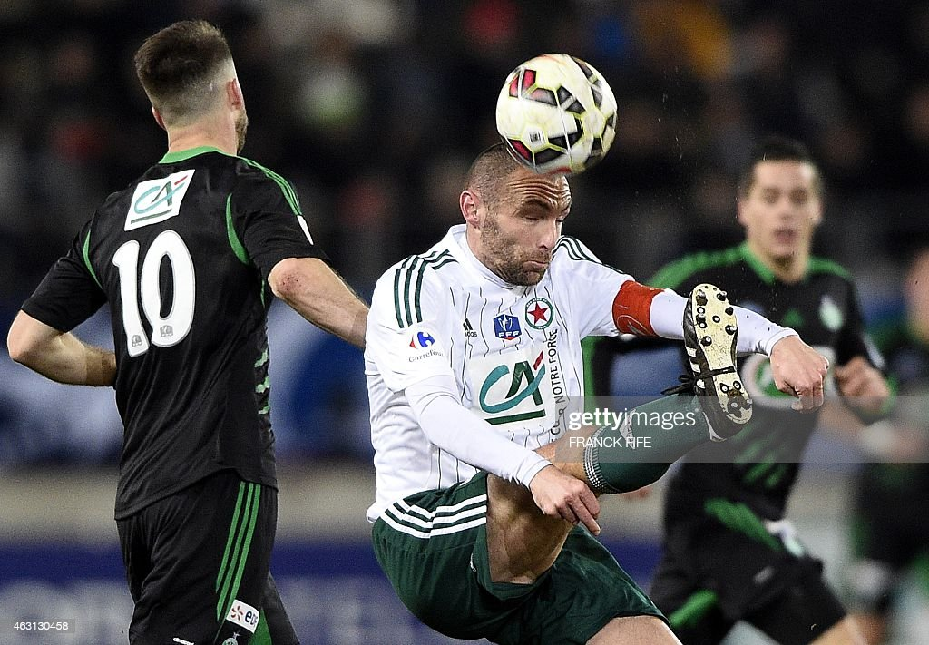 Red Star's defender Samuel Allegro (C) vies with Saint-Etienne's French midfielder <a gi-track='captionPersonalityLinkClicked' href=/galleries/search?phrase=Renaud+Cohade&family=editorial&specificpeople=2626266 ng-click='$event.stopPropagation()'>Renaud Cohade</a> during the French Cup football match Red Star vs AS Saint-Etienne (ASSE) at the Jean Bouin stadium in Paris on February 10, 2015.