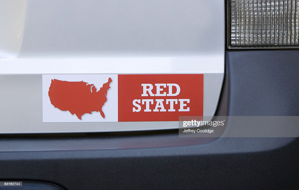 Red state bumper sticker on car : Stock Photo