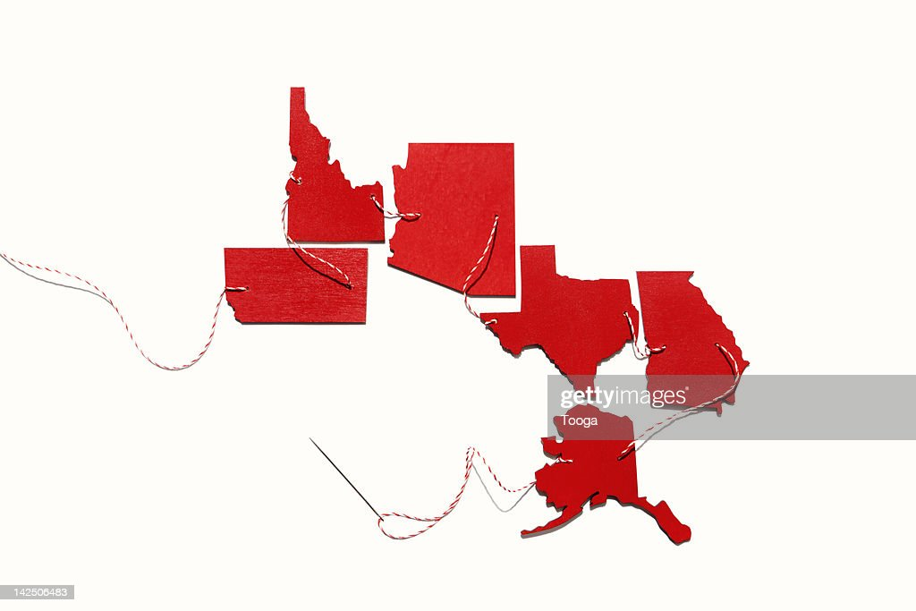 Red states connected by thread : Stock Photo